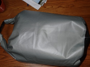dry bag holding my sleeping mat and cover